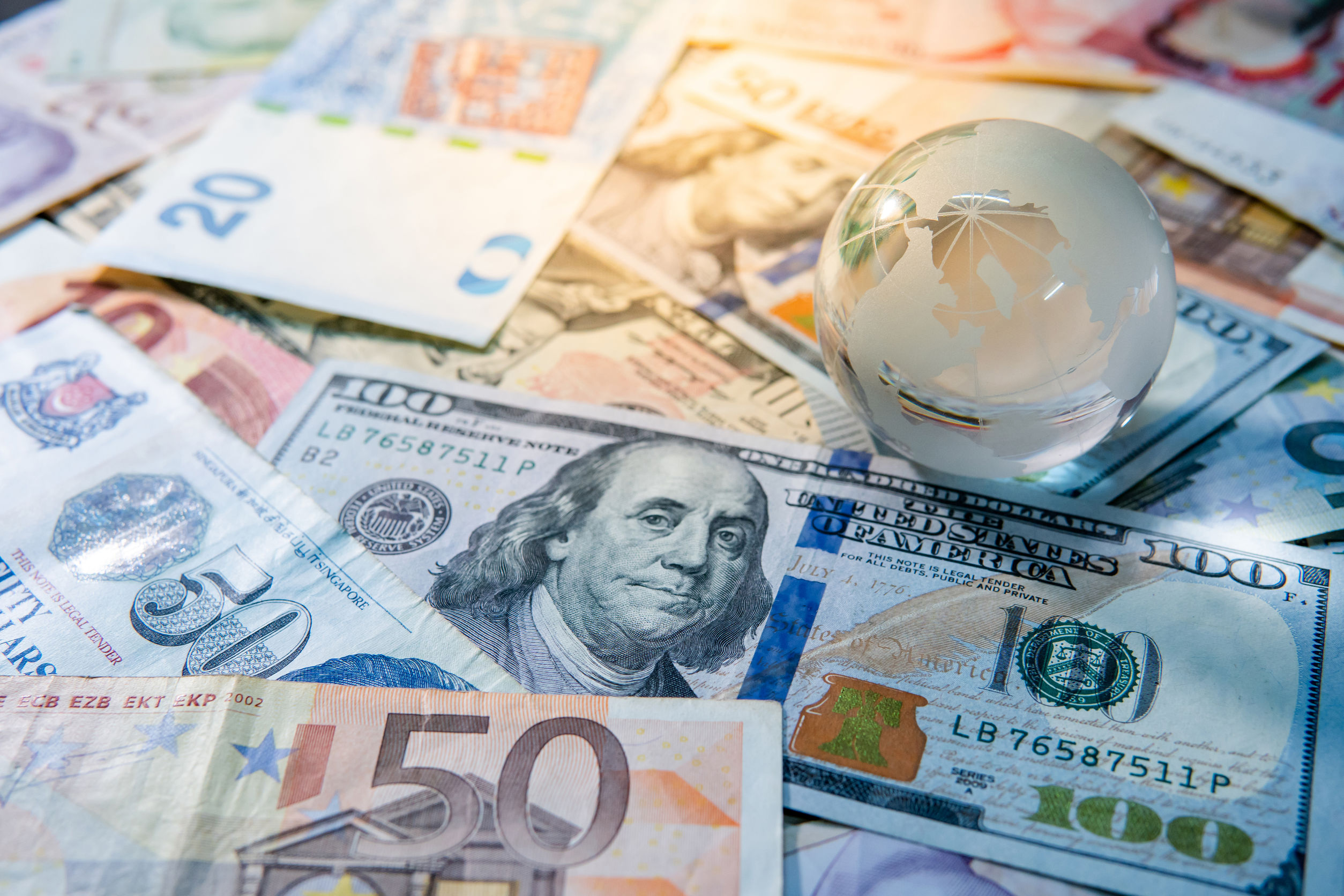 Making international payments and setting prices in a foreign currency